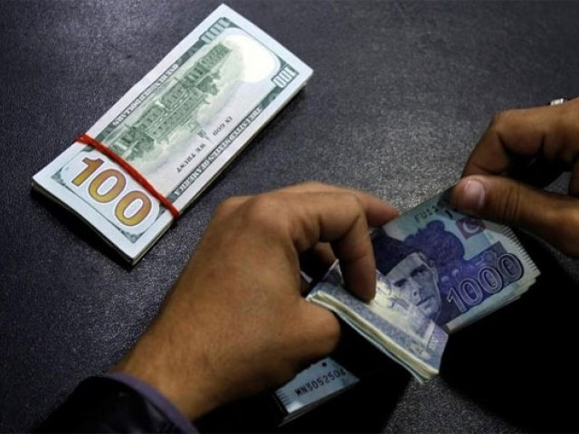 Currency has lost Rs8.26 since Wednesday under latest round of devaluation. PHOTO: REUTERS