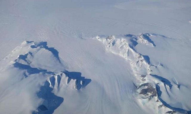 A new NASA study says that Antarctica is overall accumulating ice. Still, areas of the continent, like the Antarctic Peninsula photographed above, have increased their mass loss in the last decades. PHOTO: NASA