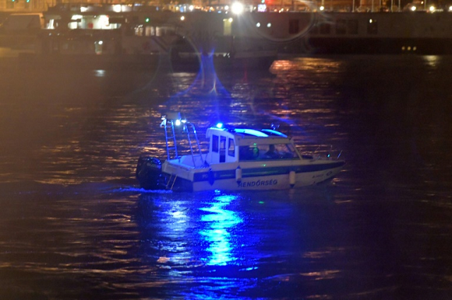 Police search for survivors after the Hungarian 'Hableany' (Mermaid) riverboat capsized after a collision on the Danube River in Budapest. PHOTO: AFP