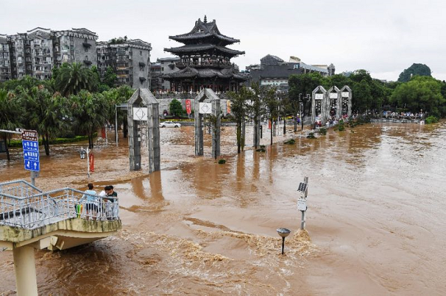 Streets in Guilin are submerged by floodwater on June 9, 2019 in China's southern Guangxi region after heavy rains. PHOTO: AFP