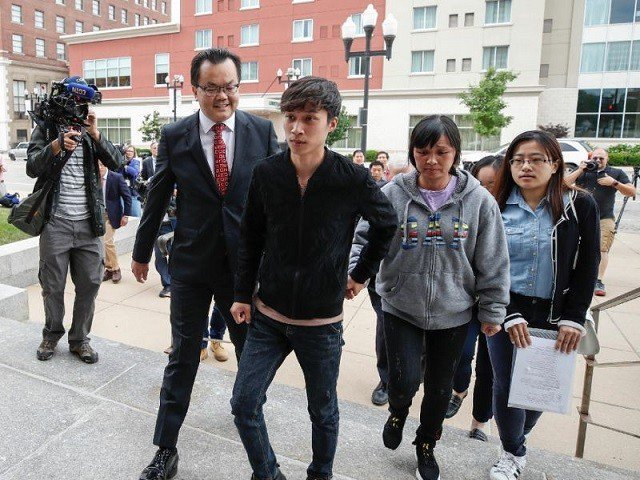 The brother (C) and mother (2ndR) of Chinese scholar Zhang Yingying arrive at a federal court in Peoria, Illinois for the trial of Brendt Christensen, who is suspected of kidnapping and killing Zhang in June 2017. PHOTO: AFP
