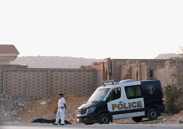 Policemen guard outside the cemetary where the lawyers of ousted Egyptian Islamist President Mohamed Mursi say he was buried, early morning in Cairo, Egypt. PHOTO: REUTERS