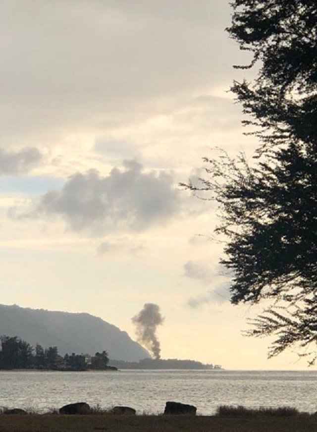 A plume of smoke rises after an airplane crash, seen from Kaiaka Bay Beach Park, in Haleiwa, Hawaii, US. PHOTO: REUTERS