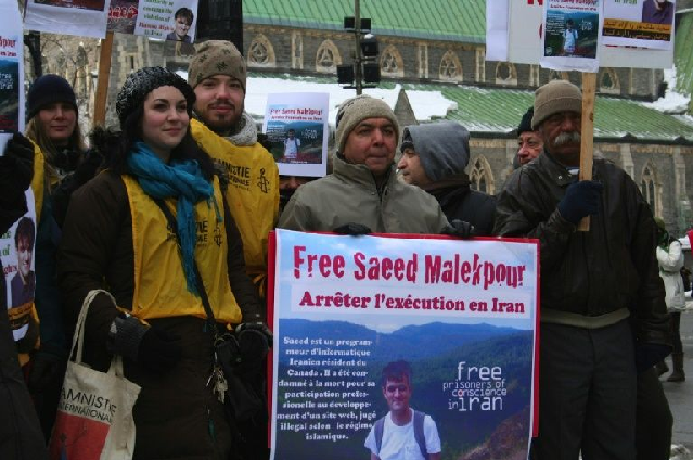 This photo shows supporters demonstrating for the release of Saeed Malekpour in Montreal, Canada. PHOTO: AFP