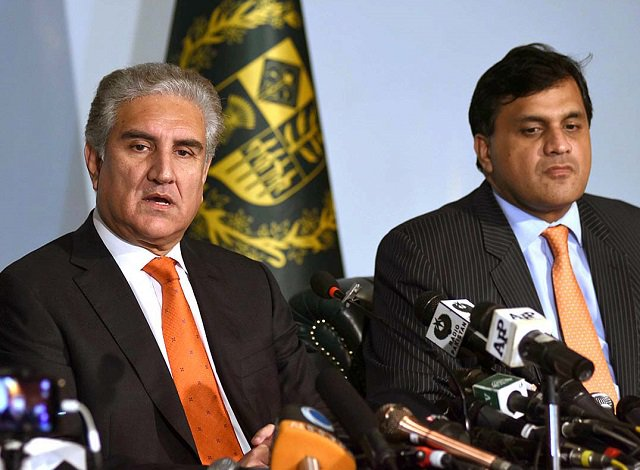 Foreign Minister Shah Mehmood Qureshi and FO spokesperson Dr Muhammad Faisal. PHOTO: APP