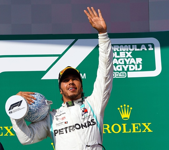 on lap 49, Hamilton pitted again, taking mediums in 2.4 seconds. He re-joined second, 21 seconds adrift, Mercedes' tactic leaving Red Bull without time to respond. PHOTO: AFP