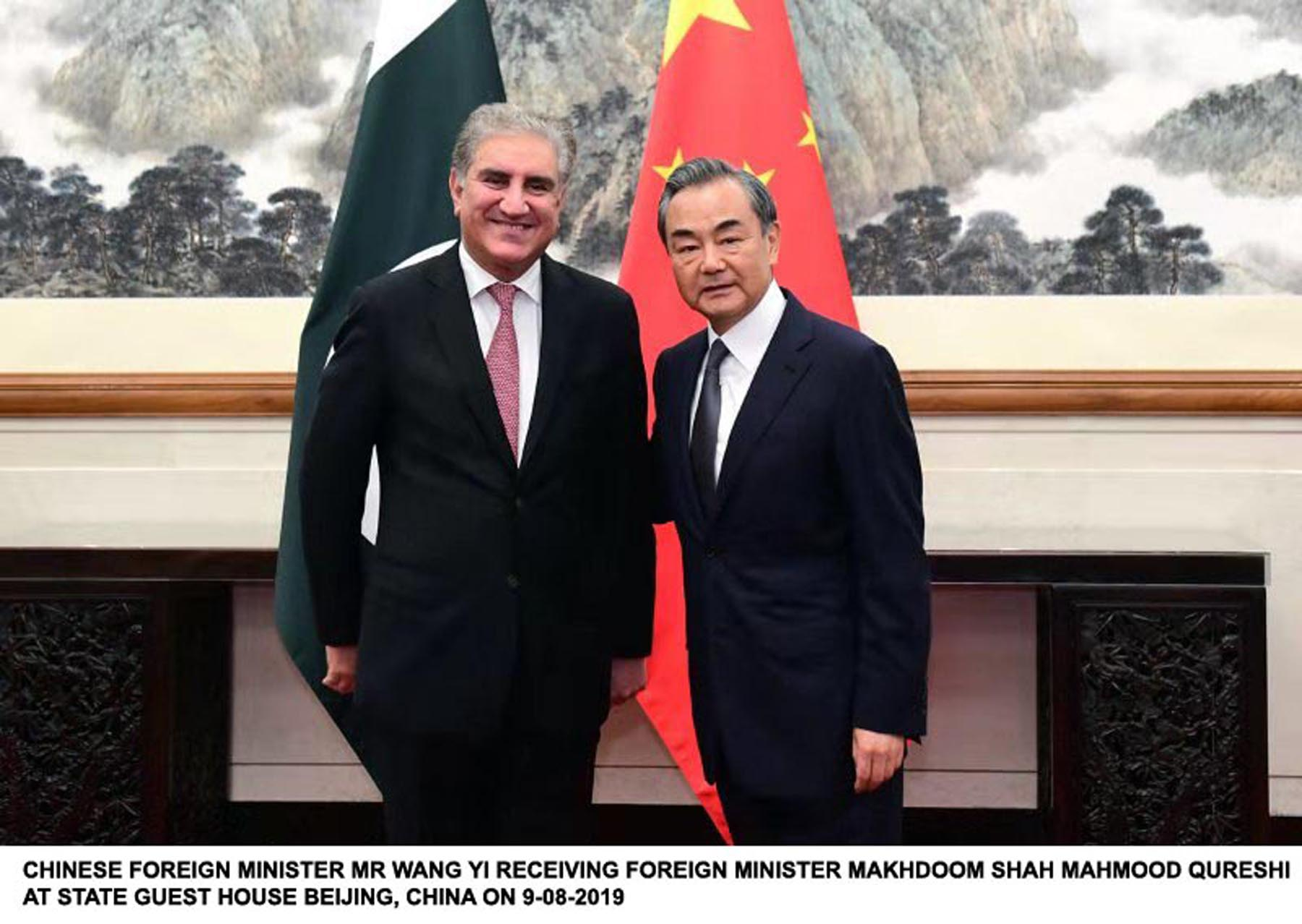 Foreign Minister Shah Mehmood Qureshi with Chinese counterpart Wang Yi in Beijing. PHOTO: PID