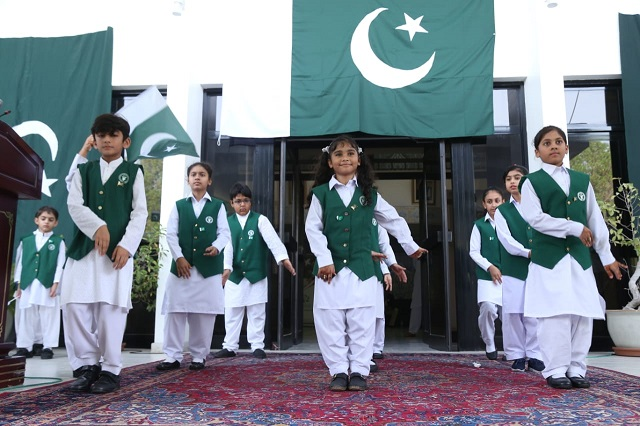 Children perform tableau during the Independence Day celebration held at Pakistan Embassy in Abu Dhabi. PHOTO: EXPRESS