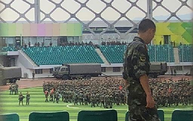 Military personnel parade inside the stadium. PHOTO: AFP
