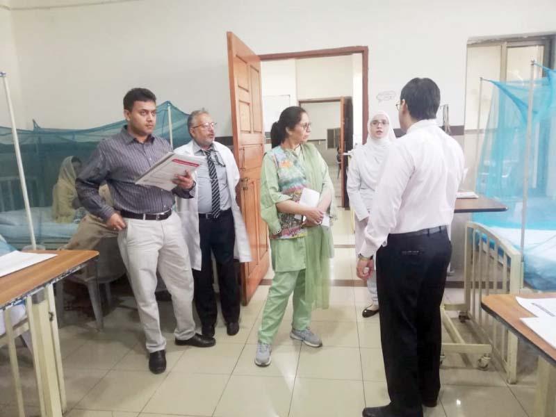 Punjab Health Department Director Shehnaz Nasreen reviews arrangements at dengue ward in BBH. PHOTO: EXPRESS
