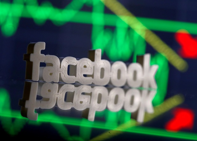 A 3D-printed Facebook logo is seen in front of displayed stock graph in this illustration photo, March 20, 2018. PHOTO:REUTERS
