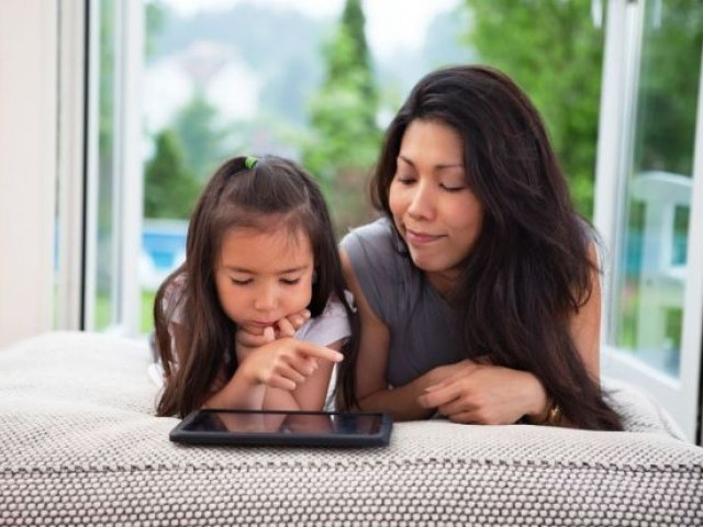 According to researchers, parents should find a balanced way to monitor their children's internet use. PHOTO: AFP