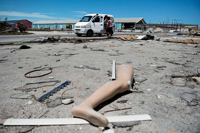 The leg of a dismantled mannequin is seen next to damage caused by Hurricane Dorian on September 5, 2019, in Marsh Harbour, Great Abaco Island in the Bahamas. PHOTO: AFP