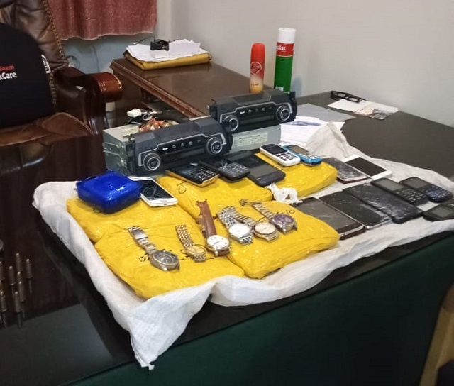 Hand grenades, six kilos of hashish and other looted goods including mobile phones and wrist watches recovered in Sohrab Goth raid. PHOTO: EXPRESS