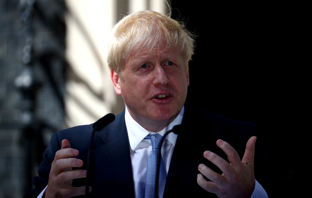 The prime minister called for parliament to vote in favour of holding an early election on October 15. PHOTO: REUTERS