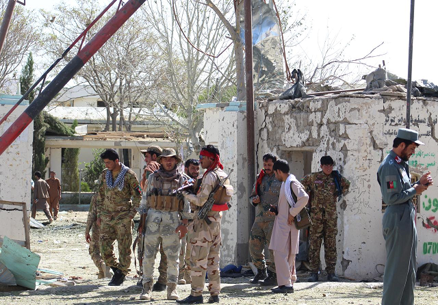 Afghan security forces stand at the site of a car bomb attack in Qalat, capital of Zabul province, Afghanistan September 19, 2019. PHOTO: REUTERS