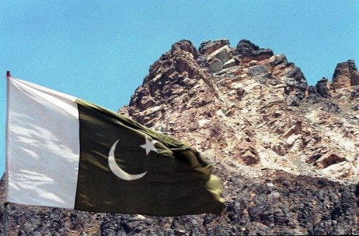 Pakistan's national flag flies near the hill under which the country's five nuclear tests were carried out. PHOTO: AFP/FILE