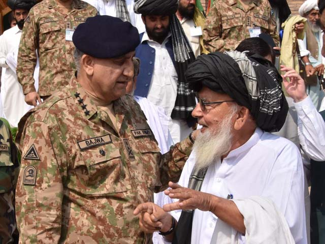 General Qamar interacts with a tribal elder during his visit to Miranshah on Friday. PHOTO: ISPR