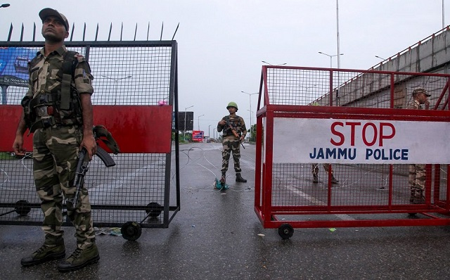 Security personnel stand guard at a roadblock in Jammu on August 7, 2019. PHOTO: AFP