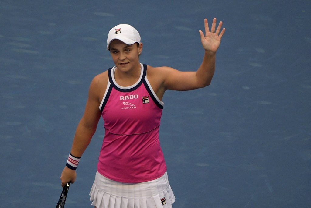 FULL OF FAULTS: Barty committed 52 unforced errors but still just about emerged victorious in a nervy 6-3, 3-6, 7-6 (9/7) triumph in Beijing. PHOTO: AFP