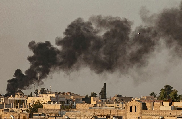 Smoke billows following Turkish bombardment on Syria's northeastern town of Ras al-Ain in the Hasakeh province along the Turkish border on October 9, 2019. PHOTO: AFP