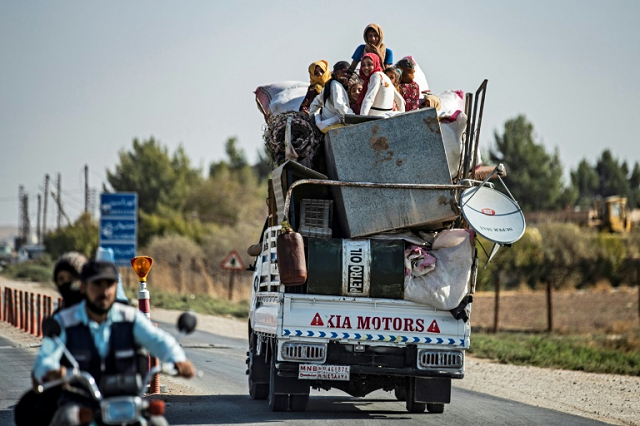 Civilians fled their homes in vehicles or on foot with their belongings. PHOTO: AFP