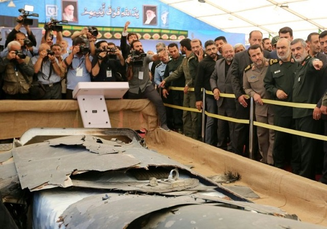 Iran has put what it says is the debris of a US drone it shot down over the Gulf in June on display in a special exbition in Tehran. PHOTO: AFP/FILE
