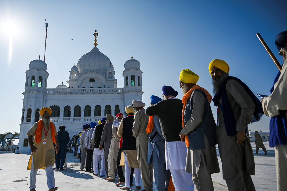 Sikh Pilgrims stand in a queue to visit the Shrine of Baba Guru Nanak Dev at Gurdwara Darbar Sahib in Kartarpur, on November 9, 2019. PHOTO: AFP