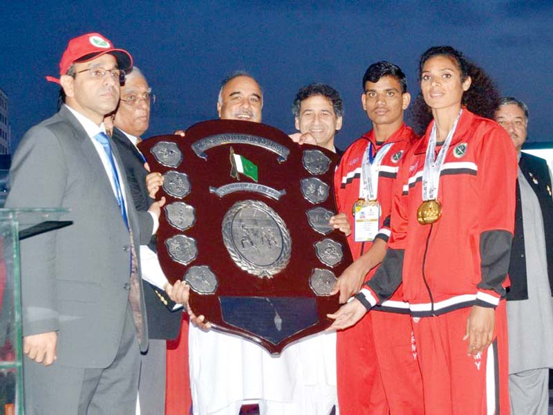 Best-performing athletes of the Pakistan Army receive the 33rd National Games championship trophy. PHOTO: EXPRESS