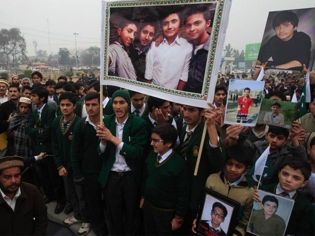APS Students in a Solidarity rally for their fellow classmates who were victims of a gruesome attack. PHOTO: REUTERS