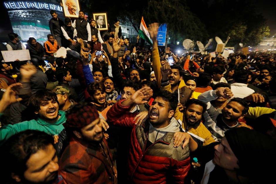Demonstrators protesting outside police headquarters. PHOTO: REUTERS