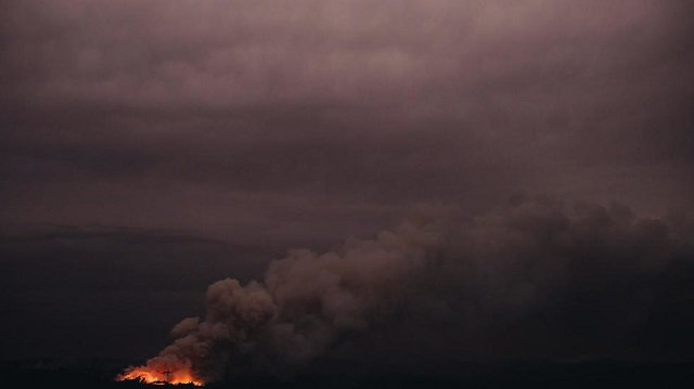 Chile's meteorological service said Monday that smoke from the fires was visible in Chile and Argentina. PHOTO: AFP