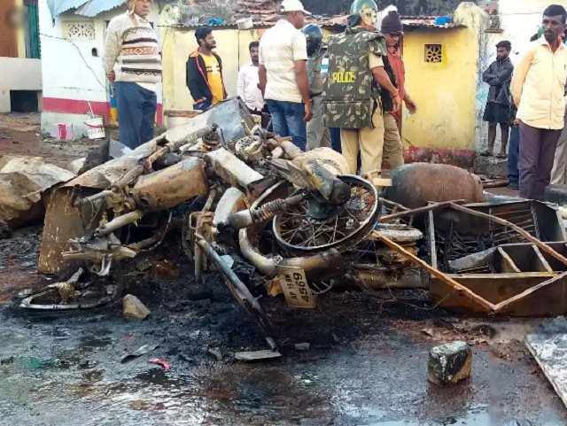 Nearly two dozen homes and as many vehicles were torched in riots. PHOTO COURTESY: TIMES OF INDIA