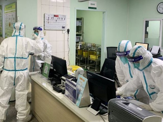 Medical staff members wearing protective suits at the Zhongnan hospital in Wuhan in China's central Hubei province. PHOTO: AFP