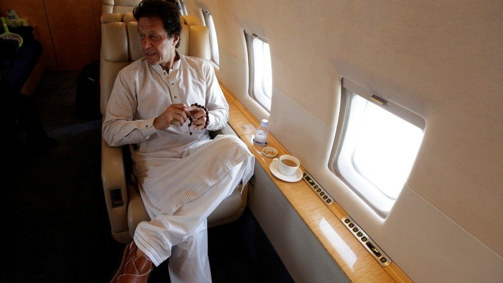 A Reuters file photo of Imran Khan in a plane.
