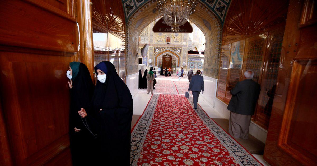 Iraqi female pilgrims wearing protective face mask at Imam Ali Shrine. PHOTO: REUTERS