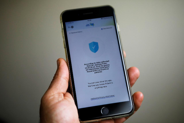 A mobile phone with HaMagen application on it is seen in this picture illustration taken on April 1, 2020. PHOTO: REUTERS