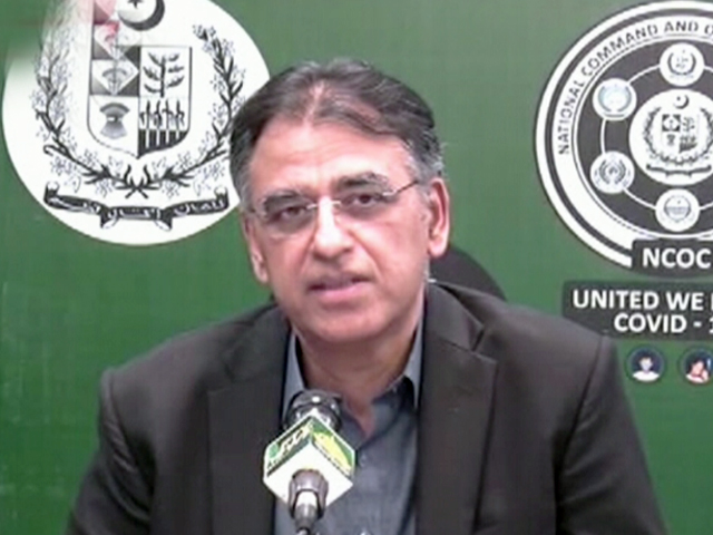 Planning Minster Asad Umar addresses a news conference in Islamabad. SCREENGRAB