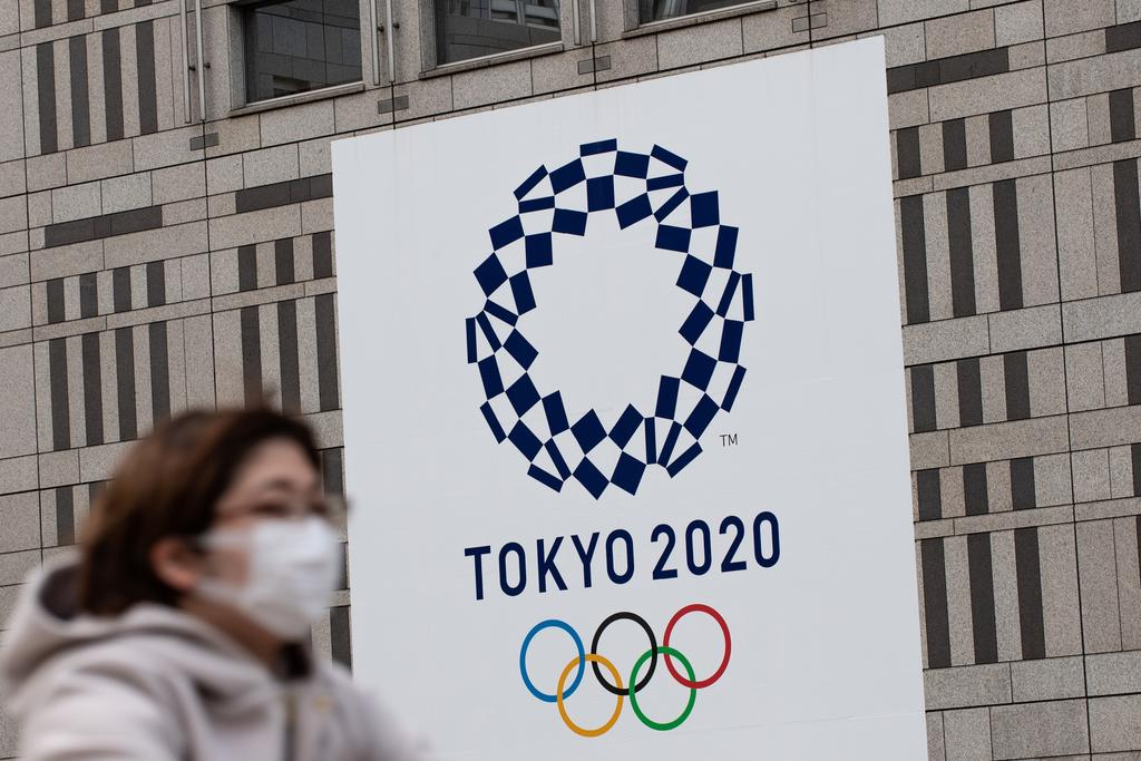 "Mori noted the Games had been cancelled previously only during wartime, and compared the battle against coronavirus to ""fighting an invisible enemy"". PHOTO: AFP"