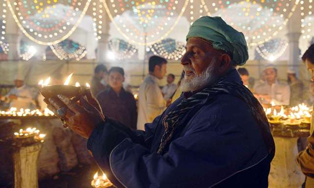A sufi dances outside the Data Darbar complex which contains the shrine of Saint Syed Ali bin Osman Al-Hajvery, popularly known as Data Ganj Bakhsh. PHOTO: AFP