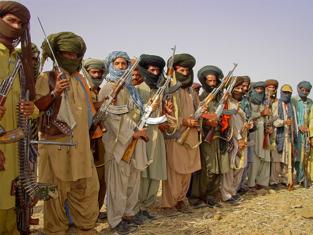 Baloch rebels holding their weapons as they pose for a photograph at an undisclosed location in Balochistan. PHOTO: REUTERS