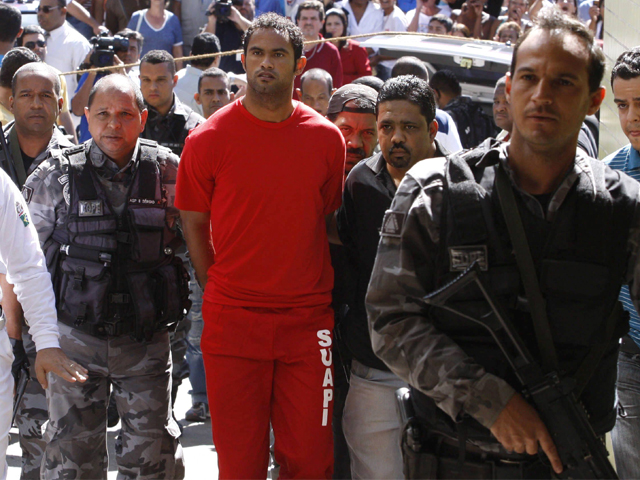 The footballer is seen here being taken into custody in 2010 in connection with the disappearance of his girlfriend. PHOTO: AFP