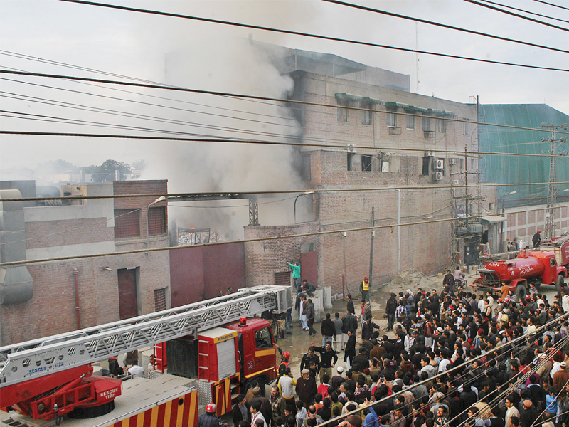Cause of fire undetermined, workers remain safe. PHOTO: SHAFIQ MALIK/EXPRESS