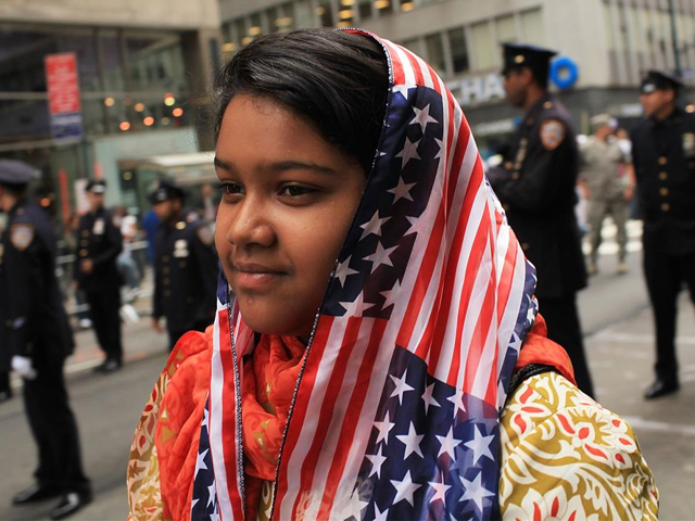 Aliza Fatima, 12, of Queens and a descendent of Pakistani parents, participates in the American Muslim Day Parade on September 26, 2010 in New York. PHOTO: GETTY