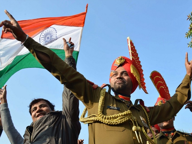 Indian Border Security Force personnel dance as they celebrate Republic Day at the India-Pakistan Wagah border post. PHOTO: AFP