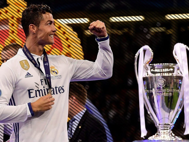 The Portguese superstar has now picked up ten different major awards and trophies in the last 372 days. PHOTO: AFP