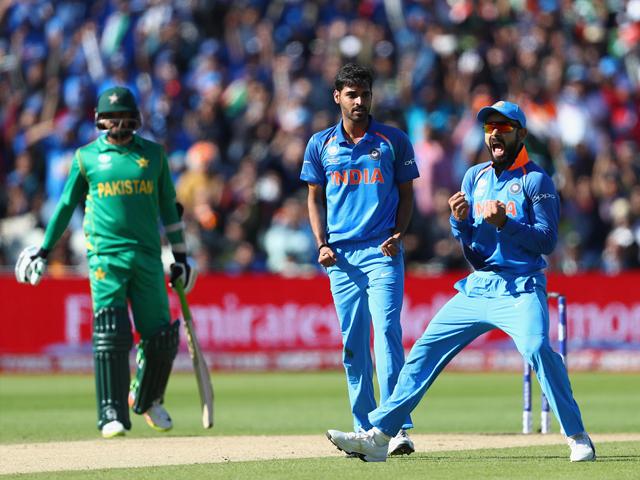 Virat Kohli gives Ahmed Shehzad a send-off after Bhuvneshwar Kumar gets him lbw , India v Pakistan, Champions Trophy, Group B, Birmingham, June 4, 2017. PHOTO: GETTY