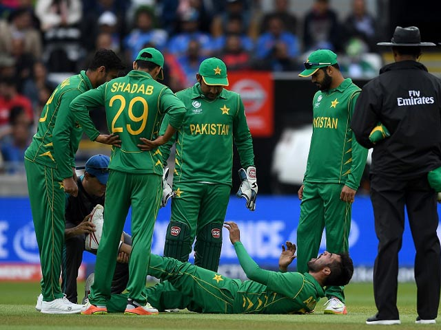 Mohammad Amir hurt his left leg and left the field , India v Pakistan, Champions Trophy, Group B, Birmingham, June 4, 2017. PHOTO: GETTY