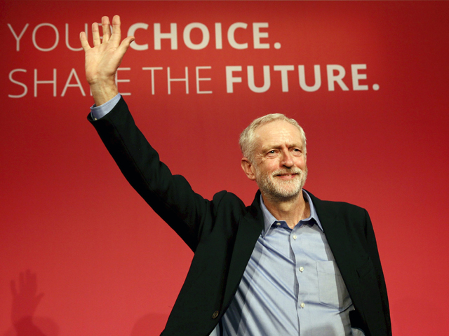 The new leader of Britain's opposition Labour Party Jeremy Corbyn waves after making his inaugural speech at the Queen Elizabeth Centre in central London, September 12, 2015. PHOTO: REUTERS