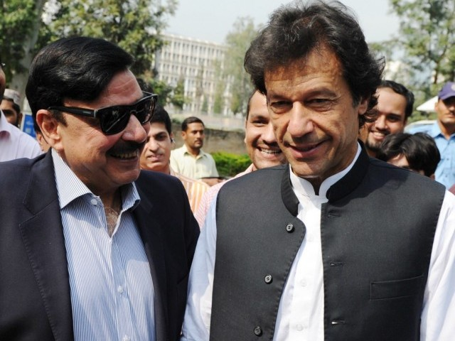 File photo of PTI chairman Imran Khan (R) and Awami Muslim League leader Sheikh Rashid Ahmed (L). PHOTO: AFP/ FILE